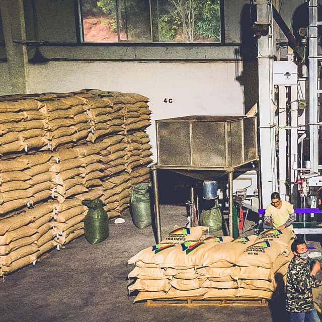 Green coffee awaits export from the dry mill in Pu'er - in the specialty coffee export business, both quality and consistency are really important.